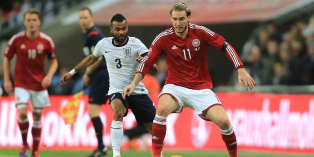 England's Ashley Cole (left) and Denmark's Nicklas Bendtner (right) battle for the ball
