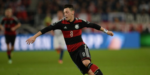 Germany's midfielder Mesut Ozil plays the ball during the International friendly football match Germany vs Chile in Stuttgart, southwestern Germany, on March 5, 2014.  Germany won the match 1-0. AFP PHOTO / PATRIK STOLLARZ        (Photo credit should read PATRIK STOLLARZ/AFP/Getty Images)
