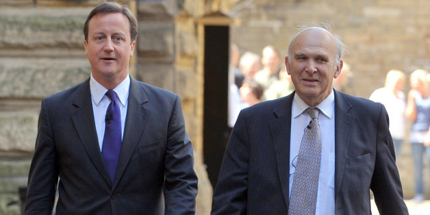 British Prime Minister David Cameron arrives with Business Secretary Vince Cable to speak to members of the local business community at PACE in Shipley, West Yorkshire, where Cameron set out the Government's strategy for economic growth.