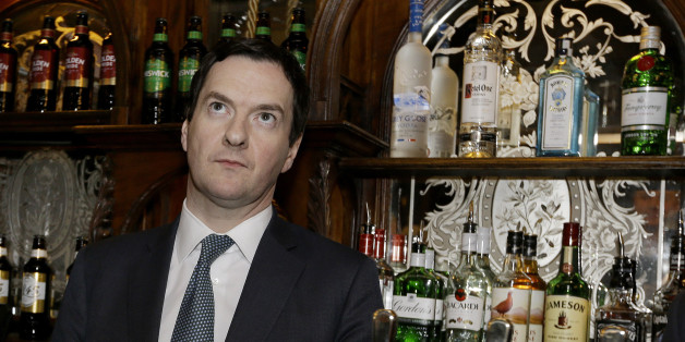 LONDON, ENGLAND - FEBRUARY 25:  Britain's Chancellor of the Exchequer George Osborne stands behind the bar during a visit to officially re-open The Red Lion pub following a major refurbishment in Westminster on February 25, 2014 in London, England.  (Photo by Kirsty Wigglesworth - WPA Pool/Getty Images)