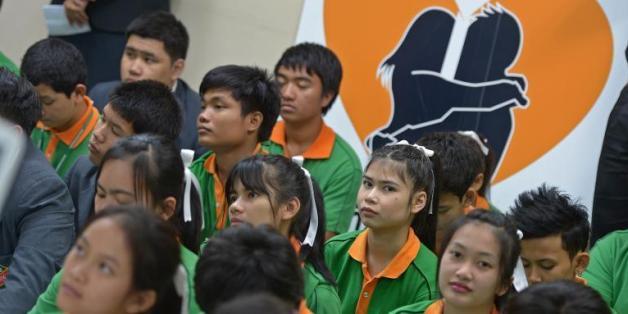 Des adolescents thaïlandais dans un cours d'éducation sexuelle du collège Panyapiwat à Bangkok le 28 octobre 2013