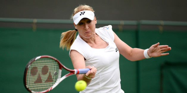 LONDON, ENGLAND - JUNE 24:  Elena Baltacha of Great Britain hits a forehand during the Ladies Singles match against Flavia Pennetta of Italy on day one of the Wimbledon Lawn Tennis Championships at the All England Lawn Tennis and Croquet Club on June 24, 2013 in London, England.  (Photo by Dennis Grombkowski/Getty Images)