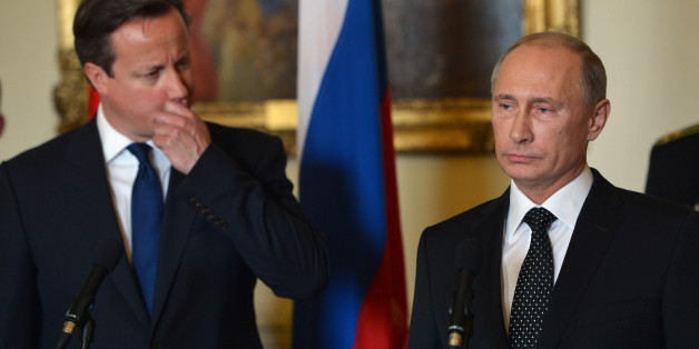 Prime Minister David Cameron and Russian President Vladimir Putin speak as they take part in a ceremony to award the Russian Ushakov medal to Arctic convoy veterans inside 10 Downing Street, London.