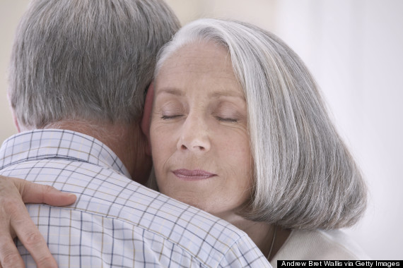 older couple cuddling