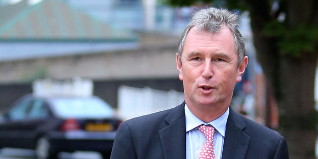 MP Nigel Evans arrives for a preliminary hearing at Preston Crown Court, he is accused of sex offences against seven men.