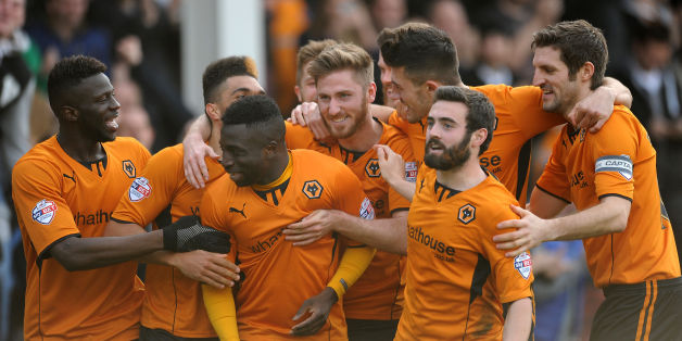 Wolves won 3-0 at Walsall to move up to first