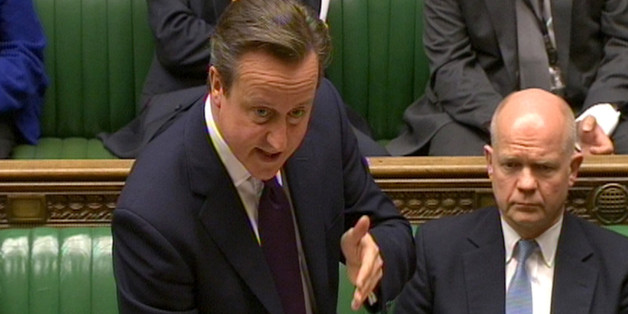 Prime Minister David Cameron reads a statement in the House of Commons, London, regarding the crisis in Ukraine.