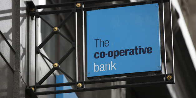 A logo sits on a sign outside a Co-Operative Bank Plc bank branch in London, U.K., on Friday, Nov. 29, 2013. Co-Operative Bank Plc, which is trying to plug a 1.5 billion-pound ($2.5 billion) capital shortfall, needs two-thirds of holders of its undated junior debt to vote on a debt-for-equity swap for it to be valid, according to company filings. Photographer: Simon Dawson/Bloomberg via Getty Images