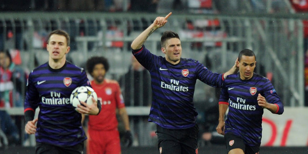 MUNICH, GERMANY - MARCH 13:  Olivier Giroud (2ndR) celebrates scoring the 1st Arsenal goal with Theo Walcott (R) during the UEFA Champions League Round of 16 second leg match between Bayern Muenchen and Arsenal FC at Allianz Arena on March 13, 2013 in Munich, Germany.  (Photo by Stuart MacFarlane/Arsenal FC via Getty Images)