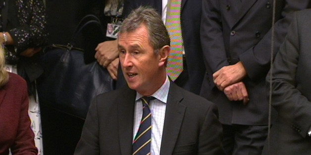 MP Nigel Evans asks a question during Prime Minister's Questions in the House of Commons, London.
