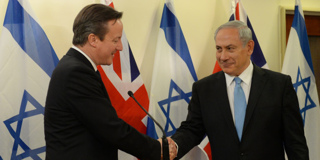 Prime Minister David Cameron is greeted by Israeli Prime Minister Benjamin Netanyahu at his office in Jerusalem on the first of a two day visit to Israel.