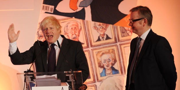 London Mayor Boris Johnson collects his award for Politician of the Year as Education Secretary Michael Gove looks on at this year's Spectator Magazine's Parliamentarian of the Year Awards, in central London.