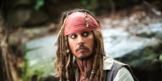 "FILE - In this file film publicity image released by Disney, Johnny Depp portrays Captain Jack Sparrow in a scene from, ""Pirates of the Caribbean: On Stranger Tides."" Captain Jack and his ""Pirates of the Caribbean"" continue to dominate the overseas box office, but not without a fight from the ""X-Men"" and ""Hangover"" gangs. (AP Photo/Disney, Peter Mountain, File)"