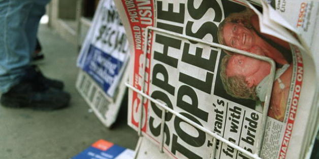 LONDON, UNITED KINGDOM - MAY 26:  A newspaper stand displays a copy of the British tabloid newspaper 'The Sun' which ran on its Page 3, normally reserved for pictures of topless models, a topless photograph of Royal bride-to-be Sophie Rhys-Jones, 26 May 1999.  The revealing picture, taken in 1988, shows Sophie with a British DJ, Chris Tarrant whilst on a Capital Radio tour in Malaga and has caused outrage here amongst Buckingham Palace. The woman who sold the picture was Today sacked from her jo