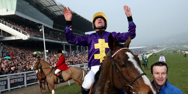CHELTENHAM, ENGLAND - MARCH 13:  Davy Russell riding Lord Windermere win The RSA Steeple Chase during Ladies Day at Cheltenham racecourse on March 13, 2013 in Cheltenham, England. (Photo by Alan Crowhurst/Getty Images)