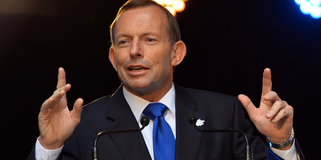 Australia's Prime Minister Tony Abbott speaks during a ceremony of the one year countdown to the ICC Cricket World Cup 2015 in Sydney on February 14, 2014. The World Cup will be held from February 14 to March 15, 2015 with 49 matches played in 14 venues across the two host nations, Australian and New Zealand. AFP PHOTO / Saeed KHAN        (Photo credit should read SAEED KHAN/AFP/Getty Images)