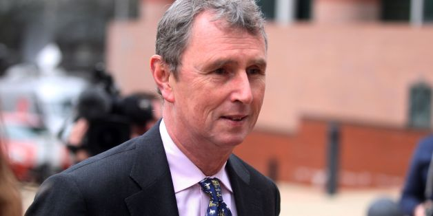 Nigel Evans, 56, of Pendleton, Lancashire, the former deputy speaker of the House of Commons (centre front ) arrives at Preston Crown Court where he faces nine charges, dating from 2002 to April 1, last year of sexual offences against seven men.