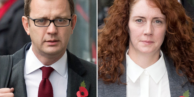 A combination of pictures created on October 31, 2013 shows Former News of the World editor and Downing Street communications chief Andy Coulson (L) and Rebekah Brooks (R), former News International chief executive, arriving for the phone-hacking trial at the Old Bailey court in London on October 31, 2013.  The two most prominent defendants in Britain's phone-hacking trial, former News of the World editors Rebekah Brooks and Andy Coulson, had a six-year affair, prosecutors said on October 31, 20