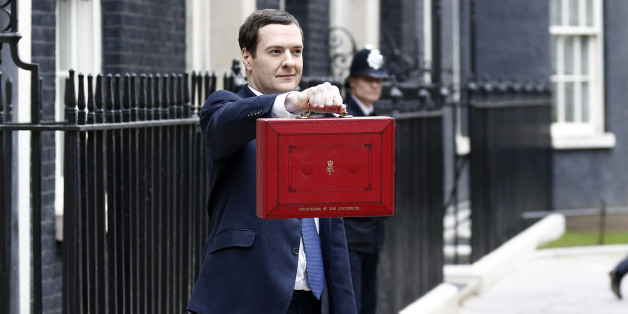 George Osborne, U.K. chancellor of the exchequer, holds the dispatch box containing the 2014 budget as members of the H.M. Treasury leave 11 Downing Street in London, U.K., on Wednesday, March 19, 2014. Osborne will lay out a budget today focused on securing Britain's economic recovery and rebutting opposition Labour Party claims that he's ignoring the rising cost of living. Photographer: Simon Dawson/Bloomberg via Getty Images