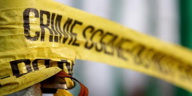 Stock image of police crime scene tape in Salford.