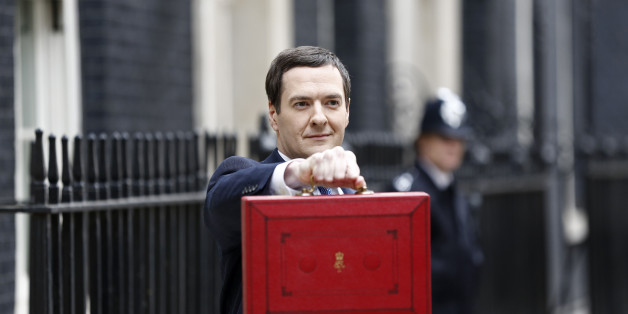 George Osborne, U.K. chancellor of the exchequer, holds the dispatch box containing the 2014 budget as he stands outside 11 Downing Street in London, U.K., on Wednesday, March 19, 2014. Osborne will lay out a budget today focused on securing Britain's economic recovery and rebutting opposition Labour Party claims that he's ignoring the rising cost of living. Photographer: Simon Dawson/Bloomberg via Getty Images