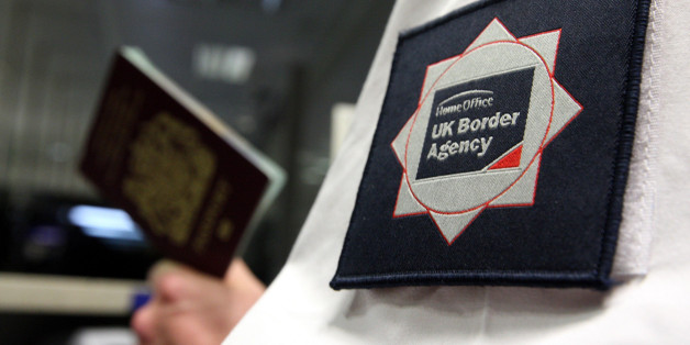 File photo dated 23/11/2009 of a UK Border Agency officer checking a passport as fewer than one in 50 reports of illegal immigration result in a person being removed from the country, a group of influential MPs has discovered.