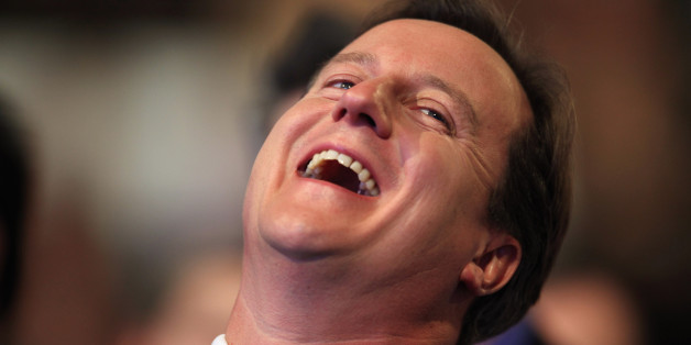 MANCHESTER, ENGLAND - OCTOBER 05:  Conservative leader David Cameron laughs while he waits to address delegates at the Conservative Party Conference on October 5, 2009 in Manchester, England. Britain's Conservatives are meeting in Manchester this week for their final party conference before next year's general election.  (Photo by Dan Kitwood/Getty Images)