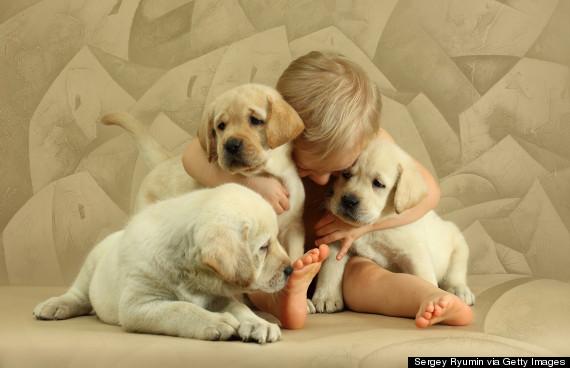 boy hugging dog