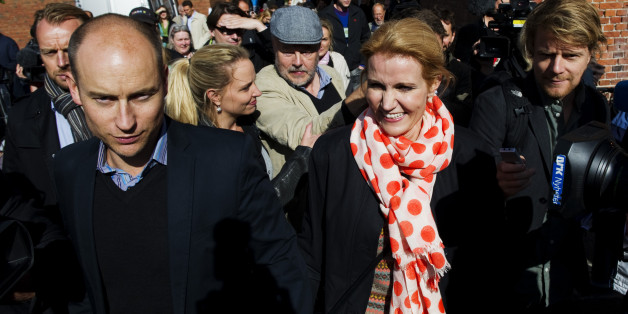 The leader of the Social Democrats, Helle Thorning-Schmidt (C) and her husband Stephen Kinnock (L) leave a polling station in a school in Copenhagen on September 15, 2011 after voting in the Danish general elections. Danes came out in droves to vote in a general election expected to bring the center-left back to power after a decade in opposition and deliver the country's first woman prime minister.    AFP PHOTO / JONATHAN NACKSTRAND (Photo credit should read JONATHAN NACKSTRAND/AFP/Getty Images