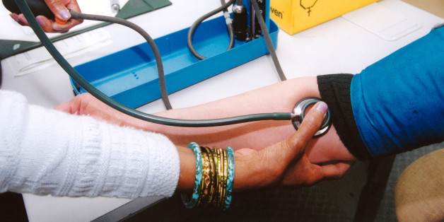 GP taking female patient's blood pressure in health centre, Reading UK. (Photo by: Photofusion/UIG via Getty Images)