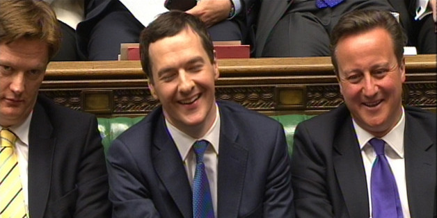 Chancellor of the Exchequer George Osborne laughs as Labour party leader Ed Miliband responds to his Budget statement to the House of Commons, London.
