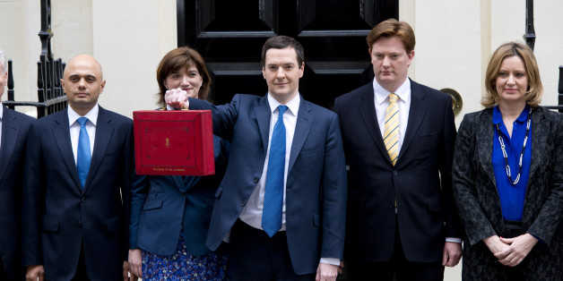 George Osborne leaves Downing Street before delivering his 2014 budget announcement at the House of Commons.