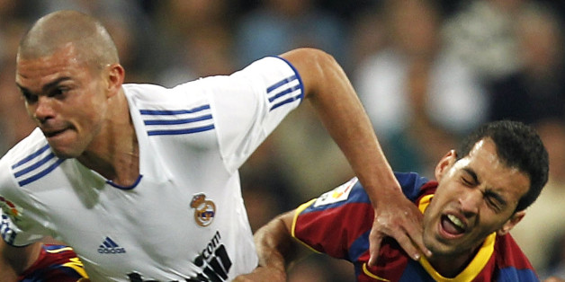 MADRID, SPAIN - APRIL 16:  Pepe of Real Madrid duels for the ball with Sergio Busquets (R) and David Villa of Barcelona during the La Liga match between Real Madrid and Barcelona at Estadio Santiago Bernabeu on April 16, 2011 in Madrid, Spain.  (Photo by Angel Martinez/Real Madrid via Getty Images)