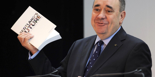 Scotland's First Minister Alex Salmond speaks during a press conference to launch his regional government's long-awaited 'white paper' ahead of next year's historic independence referendum, at Glasgow Science Centre in Glasgow, Scotland, on November 26, 2013. An independent Scotland would keep Queen Elizabeth II as its monarch but create its own defence force, nationalist leader Salmond said as he unveiled the detailed proposals. AFP PHOTO/ANDY BUCHANAN        (Photo credit should read Andy Buch