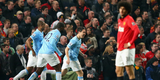 MANCHESTER, ENGLAND - MARCH 25:  Samir Nasri of Manchester City celebrates with his team-mates after Edin Dzeko scored the opening goal during the Barclays Premier League match between Manchester United and Manchester City at Old Trafford on March 25, 2014 in Manchester, England.  (Photo by Alex Livesey/Getty Images)