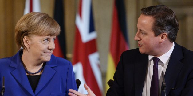 Prime Minister David Cameron with German Chancellor Angela Merkel during a press conference at 10 Downing Street, London.