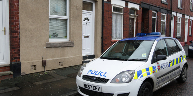 A police car outside the home of Victorino Chua, in Stockport. The 46-year-old male nurse is suspected of murdering three hospital patients at Stepping Hill Hospital in Cheshire and has been released on police bail pending further inquiries.