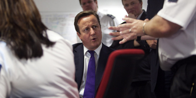 LONDION - OCTOBER 10: Prime Minister David Cameron talks to UK border agency officials in their control room during a visit to Heathrow terminal 5, on October 10, 2011 in London, England. Cameron's visit to the airport comes ahead of his talk on immigration controls.  (Photo by Richard Pohle - WPA Pool/Getty Images)
