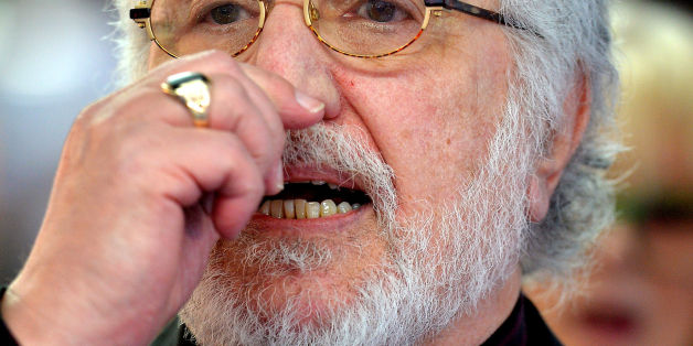 An emotional Dave Lee Travis gives a short address to the waiting media outside Southwark Crown Court, in south London, after being told he will face a re-trial for two sex offences.