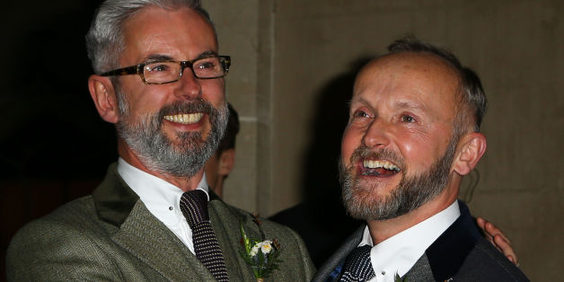 Actor Andrew Wale (left) and guesthouse owner Neil Allard pose for photographs following their wedding service in the Music Room of the Royal Pavilion, Brighton, as the new law permitting same sex marriage in England and Wales comes into force.