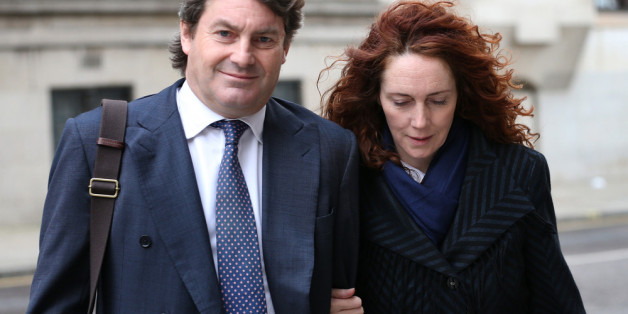 LONDON, ENGLAND - FEBRUARY 28:  Former News International chief executive Rebekah Brooks and her husband Charlie Brooks leave the Old Bailey on February 28, 2014 in London, England. Former government director of communications and News Of The World editor Andy Coulson and former News International chief executive Rebekah Brooks, along with six others, face a series of charges linked to the phone hacking of celebrities and others at the now-defunct newspaper.  (Photo by Peter Macdiarmid/Getty Ima