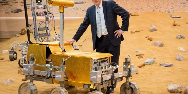 British Business Secretary Vince Cable stands with the 'Bridget' rover on the Mars Yard at Airbus Defence and Space in Stevenage, England on March 27, 2014. The Mars Yard provides a test bed area for prototype 'Rover' vehicles that may be used to provide data from the surface of the planet Mars. AFP PHOTO / LEON NEAL        (Photo credit should read LEON NEAL/AFP/Getty Images)