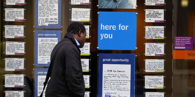 A person looks at job vacancies in a recruitment shop in Liverpool City Centre, as it was announced today that youth unemployment had reached a record high of over a million.