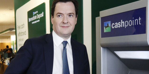Chancellor of the Exchequer George Osborne uses a Lloyds Cashpoint machine to withdraw some money during a visit to a branch of Lloyds TSB on The Strand, in central London.