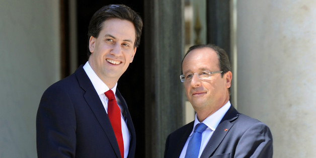French President Francois Hollande (R) welcomes British Leader of the Labour party Ed Miliband before a meeting at the Elysee Palace in Paris, on July 24, 2012.    AFP PHOTO / BERTRAND GUAY        (Photo credit should read BERTRAND GUAY/AFP/GettyImages)