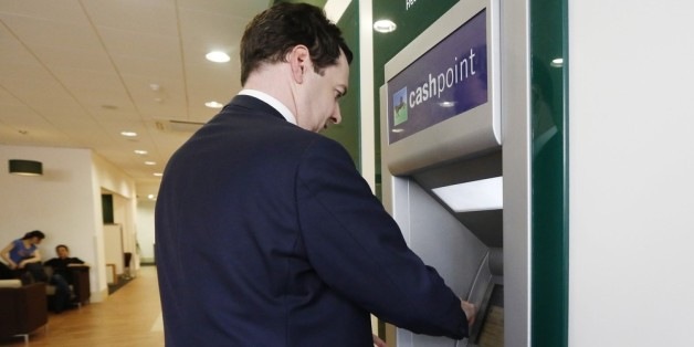 LONDON, ENGLAND - JUNE 19: Britain's Chancellor of the Exchequer George Osborne withdraws money from a cash machine during a visit to a branch of LloydsTSB bank on June 19, 2013 in London, England. The Chancellor,  is expected to outline the government's plans for the future of banks Lloyds and Royal Bank of Scotland during a speech at the Lord Mayor's Bankers and Merchants Dinner at Mansion House later. (Luke MacGregor  - WPA Pool/Getty Images)