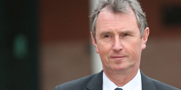 PRESTON, LANCASHIRE - JANUARY 24:  Former Deputy Speaker Nigel Evans leaves Preston Crown Court after his pre-trial hearing to face charges of sexual assault on January 24, 2014 in Preston, Lancashire. Mr Evans resigned from his position as the House of Commons deputy speaker last year. The MP for Ribble Valley has been charged with two counts of indecent assault, five of sexual assault, and one of rape against seven alleged male victims.  (Photo by Christopher Furlong/Getty Images)