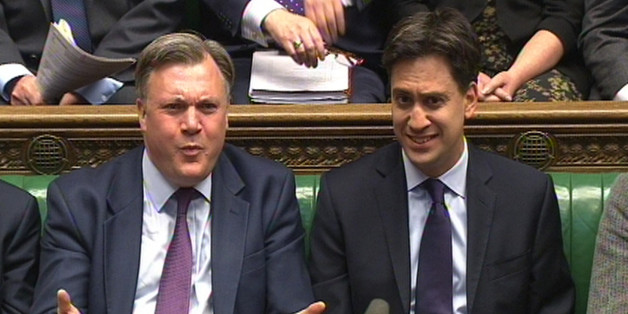 Shadow Chancellor Ed Balls (left) and Labour party leader Ed Miliband (right) listen during Prime Minister's Questions in the House of Commons, London.