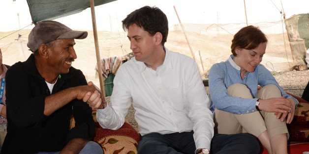 Labour leader Ed Miliband (centre) and his wife Justine (right) visit the Khan al-Ahmar Bedouin community in the West Bank.
