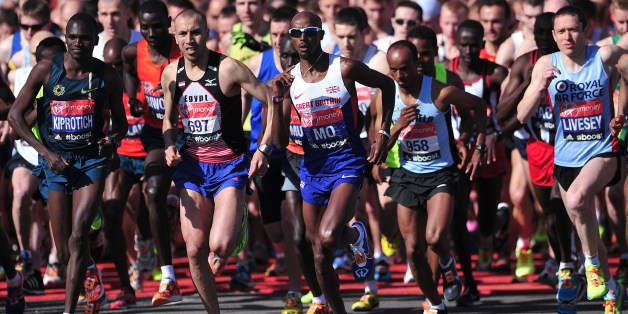 British Olympic double gold medallist Mo Farah (C) competes in the 2014 London Marathon as it passes through  Blackheath in southeast London on April 13, 2014.   Near-ideal sunny and clear conditions greeted the first runners to start the London Marathon with fans hoping for a fast pace by British favourite Mo Farah in his debut over the distance.  AFP PHOTO / CARL COURT        (Photo credit should read CARL COURT/AFP/Getty Images)